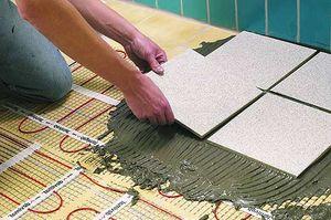 Работа по укладке плитки на систему теплого пола